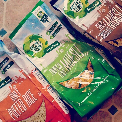"""Three bags of cereal - """"honey puffed rice"""", """"Tropical Fruit Museli"""" and """"Swiss chocolate museli"""""""
