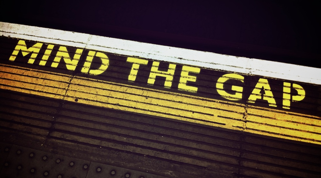"A shot of the ""mind the gap"" yellow paint at a train station"