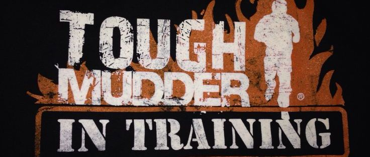 "Close up of the logo and words ""Tough Mudder in Training"" T-Shirt on a black t-shirt"